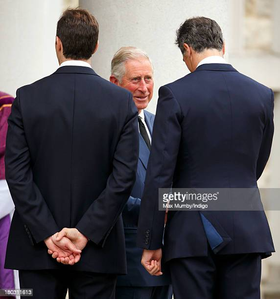 Prince Charles Prince of Wales talks with Edward van Cutsem as he attends a requiem mass for Hugh van Cutsem who passed away on September 2nd 2013 at...