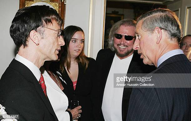 Prince Charles Prince of Wales talks with musicians Robin Gibb and Barry Gibb during a reception at Clarence House prior to The Prince's Trust 30th...