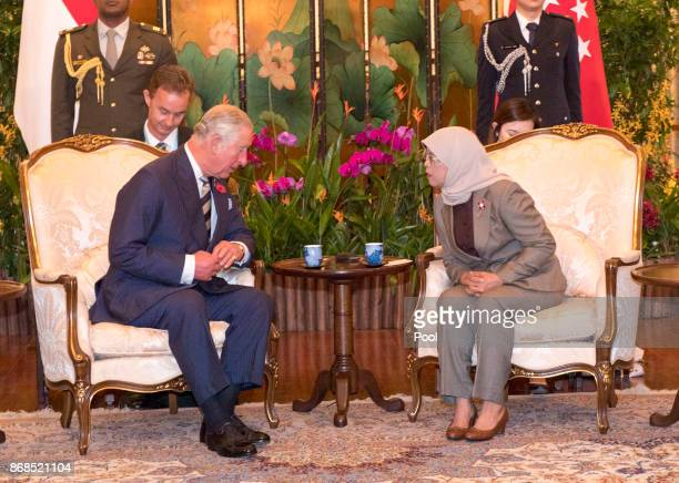 Prince Charles Prince of Wales talks with Singapore President Halimah Yacob during the British Royals official welcome and visit to Istana...
