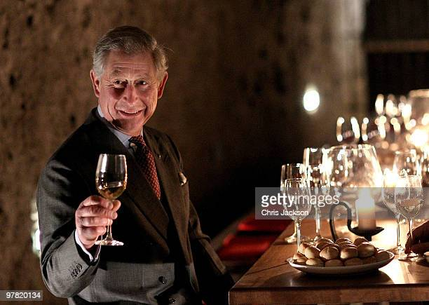 Prince Charles Prince of Wales tastes wine in a cellar as he visits the open air museum of Skanzen on March 18 2010 in Budapest Hungary Prince...