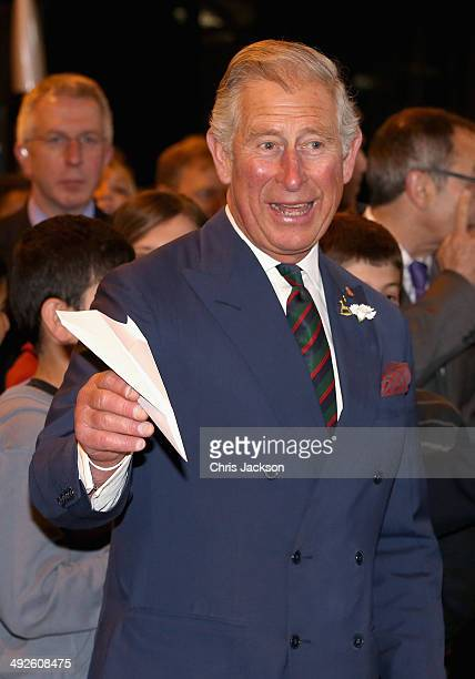 Prince Charles, Prince of Wales throw paper aeroplanes with the Prime Minister of Canada Stephen Harper at Stevenson Campus Air Hanger on May 21,...