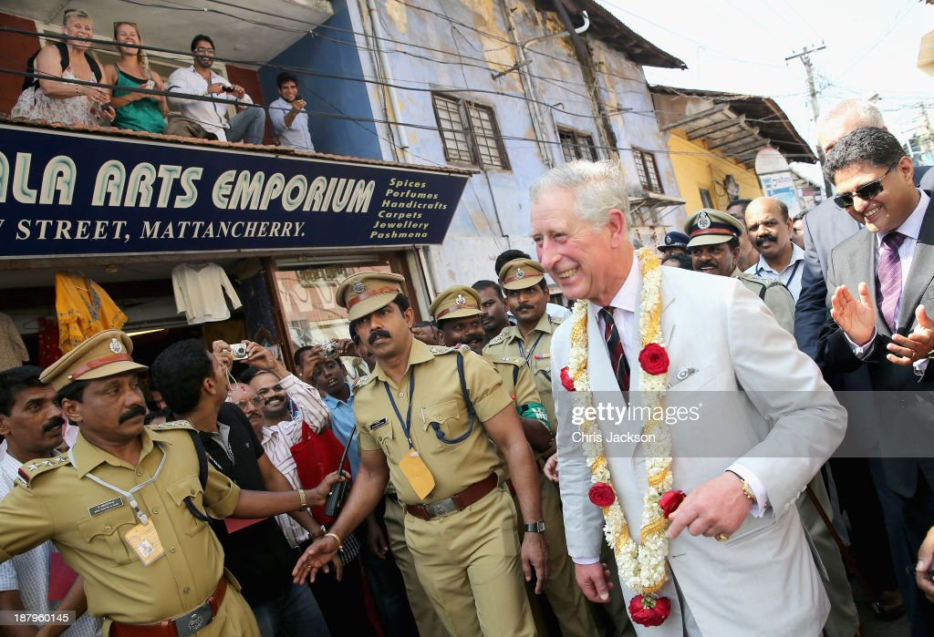 Prince Charles, Prince of Wales throws is seen after throwing a red rose to Trish Lewis (top left) who serenaded him from a balcony on his 65th birthday during a visit to Jewtown on day 9 of an official visit to India on November 14, 2013 in Kochi, India. This will be the Royal couple's third official visit to India together and their most extensive yet, which will see them spending nine days in India and afterwards visiting Sri Lanka in order to attend the 2013 Commonwealth Heads of Government Meeting.