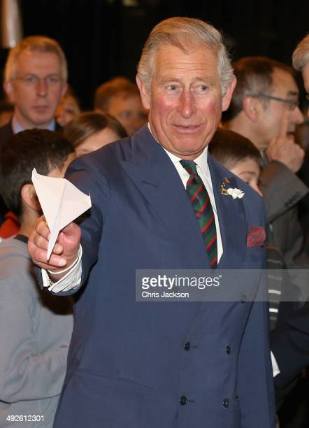 Prince Charles, Prince of Wales throws paper aeroplanes with the Prime Minister of Canada Stephen Harper at Stevenson Campus Air Hanger on May 21,...