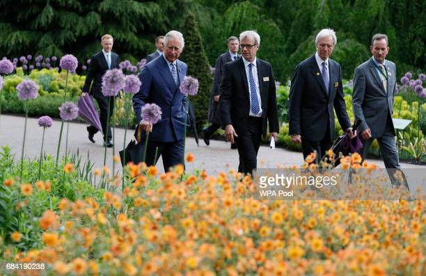Prince Charles Prince of Wales tours the Great Broad Walk during a visit to the Royal Botanic Gardens on May 17 2017 in London England Prince Charles...