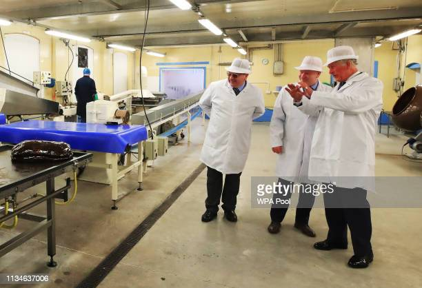 Prince Charles Prince of Wales tours the Toffee Works to celebrate 100 years of the familyrun William Santus Co Ltd's factory operating on the site...