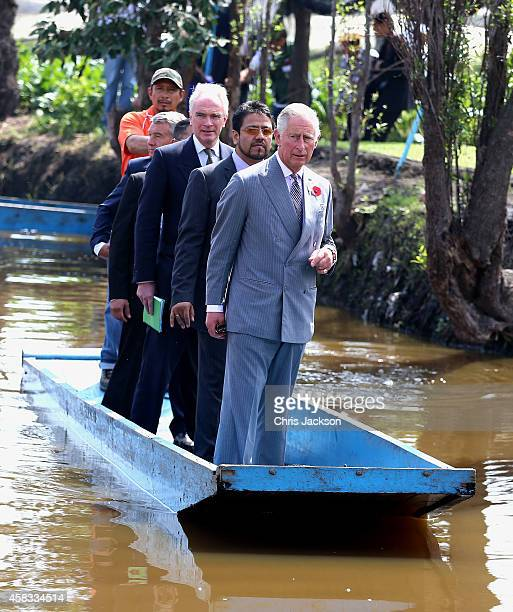 Prince Charles Prince of Wales travels on a punt as he visits a 'Chinampas' or Floating Farm just outside Mexico City on November 3 2014 in Mexico...