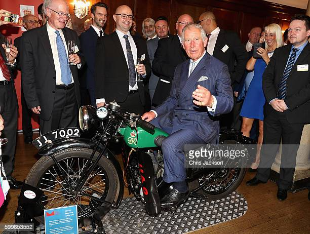 Prince Charles Prince of Wales tries a 1933 BSA 500cc motorbike used for delivering telegrams as he attends a reception to mark the 500th Anniversary...