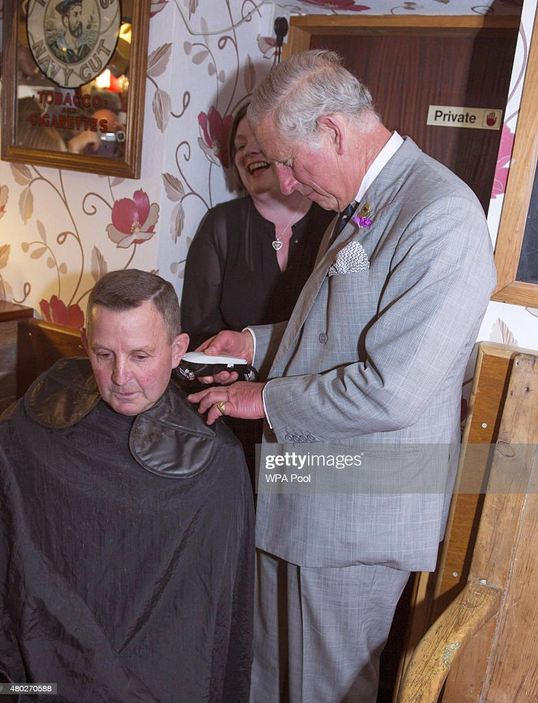 Prince Charles, Prince of Wales tries his hand at cutting hair during a visit to the Glan yr Afon Arms, which is supported by The Prince's Pub is the Hub initiative on July 10, 2015 in Talgarreg, Wales.