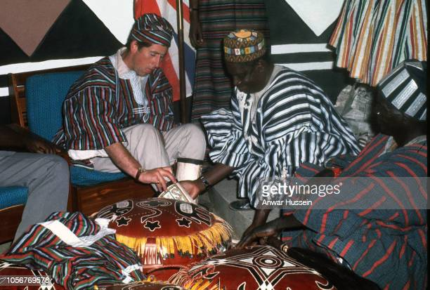 Prince Charles Prince of Wales tries on traditional clothes when he visits the Ashanti tribe on March 01 1977 in Kumasi Ghana