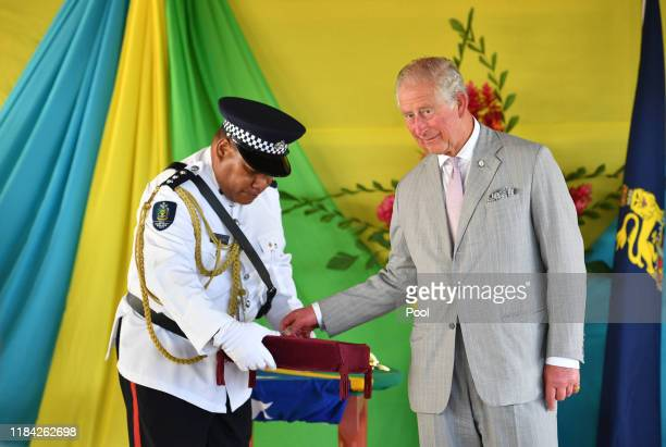Prince Charles Prince of Wales undertakes a series of Investitures during a ceremony at the Recreational Leaf Hut at Government House in Honiara...