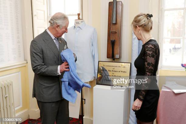 Prince Charles Prince of Wales unveils a commemorative plaque to mark his visit at the Emma Willis LTD factory while Emma Willis is watching on...
