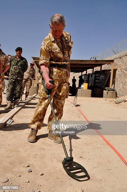 Prince Charles, Prince of Wales uses a demining device at Shorab camp, an Afghan National Army camp on March 25, 2010 in Helmand province,...