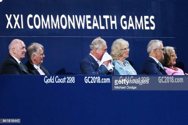 Prince Charles Prince of Wales uses his hankerchief next to his wife Camilla Duchess of Cornwall and Australian Prime Minister Malcom Turnbull during...