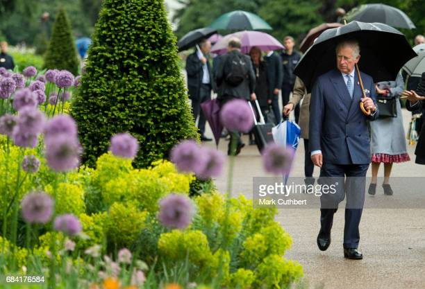 Prince Charles Prince of Wales views the Great Broad Walk Borders at Kew Gardens on May 17 2017 in London England