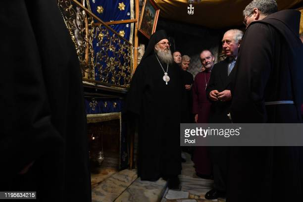 Prince Charles Prince of Wales views the manger during a visit to the Church of the Nativity on January 24 2020 in Bethlehem Israel