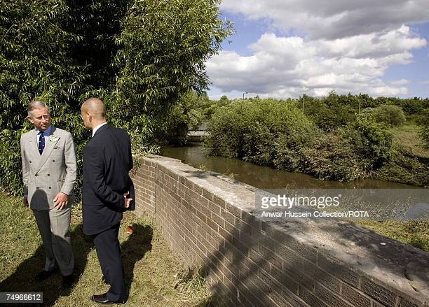 Prince Charles Prince of Wales views the river that broke its banks during a visit to flood effected areas on June 29 2007 in Catcliffe near...