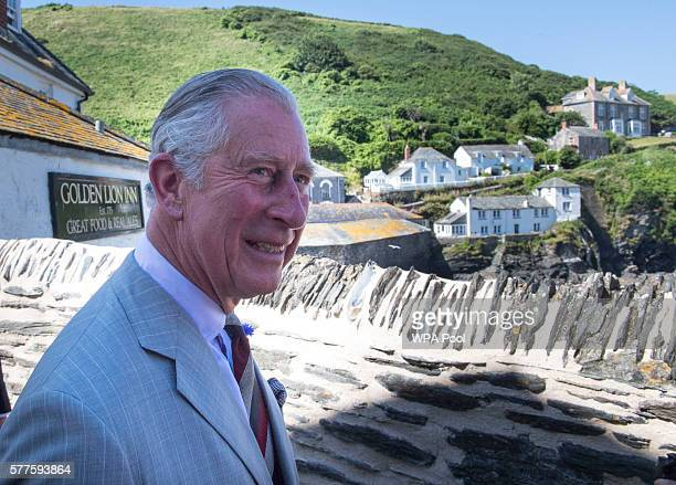 Prince Charles, Prince of Wales views the scene famous for the TV show 'Doc Martin' during a visit to Port Isaac on July 19, 2016 in Port Isaac,...