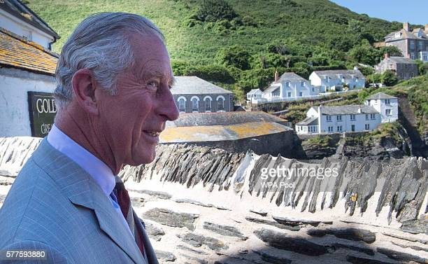 Prince Charles Prince of Wales views the scene famous for the TV show 'Doc Martin' during a visit to Port Isaac on July 19 2016 in Port Isaac England