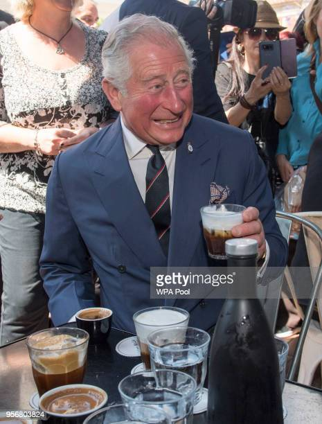 Prince Charles Prince of Wales visits a café as he take a brief walking tour of the Kapnikarea Area of central Athens during his Royal visit to...
