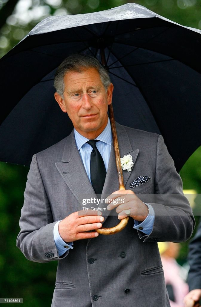 Prince Charles, Prince of Wales visits a housing development in Truro which has been built on land previously owned by The Duchy of Cornwall June 13, 2006 in Truro, England.. The Prince wears a black tie as a mark of respect following the death of his wife's father Major Bruce Shand.