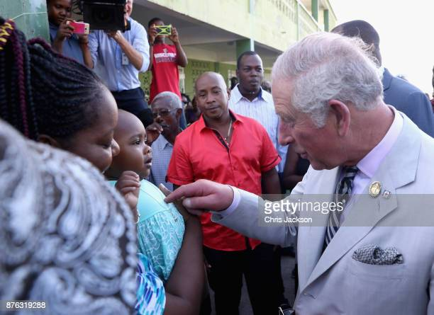Prince Charles Prince of Wales visits Pointe Michel to meet residents and tour the village observing the gorge that was left in the wake of Hurricane...