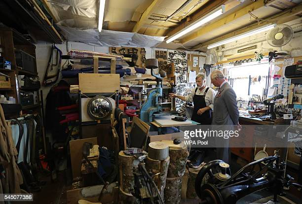 Prince Charles Prince of Wales visits Trefor Owen's workshop where Trefor hand makes clogs for dance leisure and work wear using traditional methods...