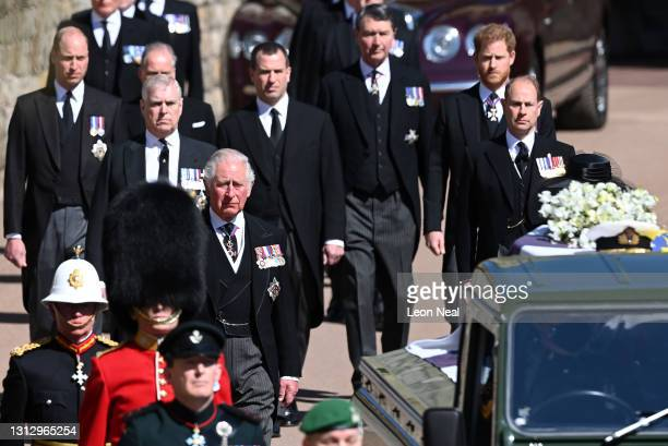 Prince Charles, Prince of Wales walks behind The Duke of Edinburgh's coffin, covered with His Royal Highness's Personal Standard, during the...