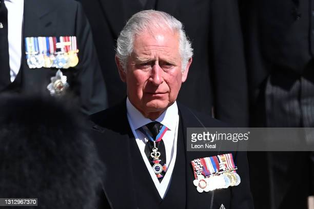 Prince Charles, Prince of Wales walks behind The Duke of Edinburgh's coffin during the Ceremonial Procession during the funeral of Prince Philip,...