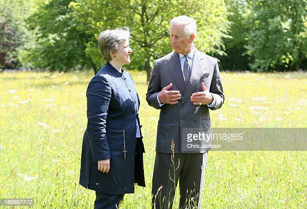 Prince Charles Prince of Wales walks in the meadows at Highgrove House with Victoria Chester of Plantlife at the launch for the Coronation Meadows...