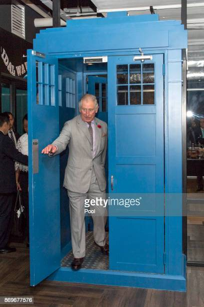 Prince Charles Prince of Wales walks through a door in the style of Dr Who's Tardis during his visit to Worq Coworking space for Young Entrepreneurs...