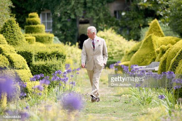 Prince Charles Prince of Wales walks through the Gardens of Highgrove House on July 19 2018 in Tetbury United Kingdom