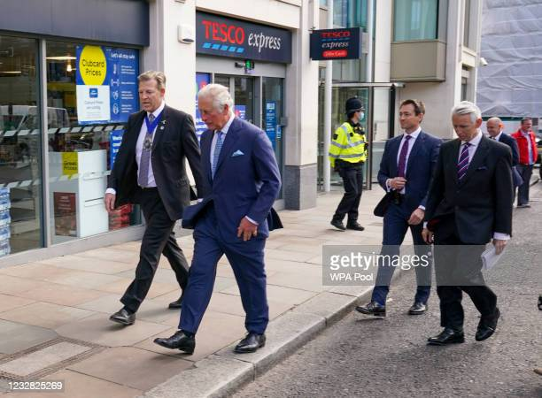 Prince Charles, Prince of Wales walks with Lord Mayor of London William Russell at Smithfield Market as he views construction and preservation work...