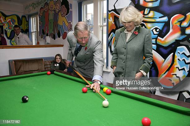 Prince Charles Prince of Wales watched by Camilla Duchess of Cornwall plays Snooker with teenagers when they visit the Jubilee Institute at Rothbury...