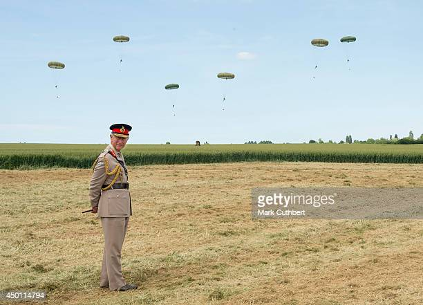Prince Charles Prince of Wales watches a commemorative parachute drop during the D Day 70 Commemorations on June 5 2014 in Ranville France Friday 6th...