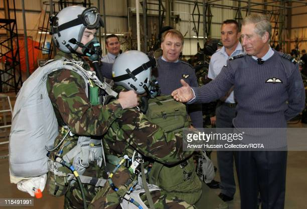 Prince Charles Prince of Wales watches a demonstration and meets parachustists during a visit to RAF Brize Norton on October 26 2007 in Brize Norton...