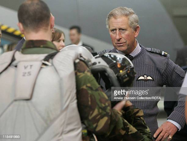 Prince Charles Prince of Wales watches a demonstration by parachustists during a visit to RAF Brize Norton on October 26 2007 in Brize Norton England...