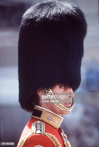 Prince Charles Prince of Wales wearing a huge bearskin and in the uniform of Colonel of the Welsh Guards takes part in Trooping the Colour ON June 17...