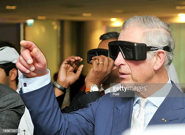Prince Charles Prince of Wales wears 3D glasses as he watches micro robotic Heart surgery during a tour of the Science and Technology park on the...