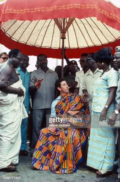 Prince Charles Prince of Wales wears a colourful tribal robe as he attends a durbar in his honour when he visits the Ashanti tribe on March 01 1977...