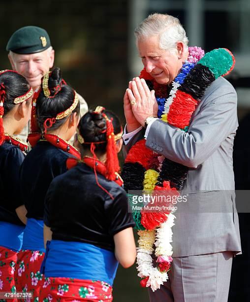 Prince Charles Prince of Wales wears a traditional garland as he visits 2nd Battalion The Royal Gurkha Rifles at Sir John Moore Barracks on July 1...
