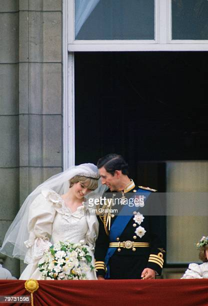 Prince Charles Prince of Wales whispering to Diana Princess of Wales on their wedding day as they appear on the balcony of Buckingham Palace