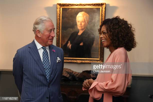Prince Charles, Prince of Wales with actress Naomi Harris during a visit to the James Bond set at Pinewood Studios on June 20, 2019 in Iver Heath,...