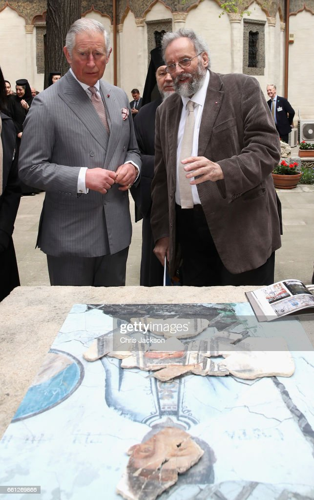 Prince Charles, Prince of Wales with artist Tim Scott Bolton during a walking tour of the Old Town on the third day of his nine day European tour on March 31, 2017 in Bucharest, Romania.