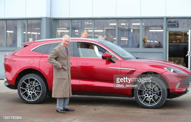 Prince Charles, Prince of Wales with Aston Martin's first SUV, the Aston Martin DBX, during his visit to the new Aston Martin Lagonda factory on...