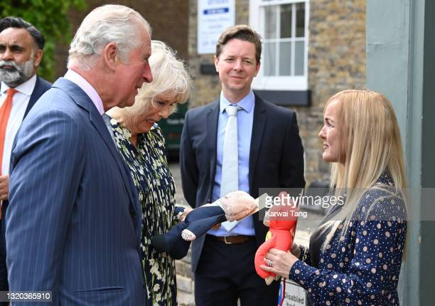 Prince Charles, Prince of Wales with Camilla, Duchess of Cornwall who gets presented with a Boris Johnson dog toy at Rex and Wolfe pet shop during a...