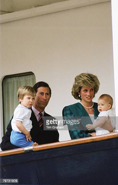 Prince Charles Prince of Wales with Diana Princess of Wales and their sons Prince Harry and Prince William on board the Royal Yacht Britannia in...
