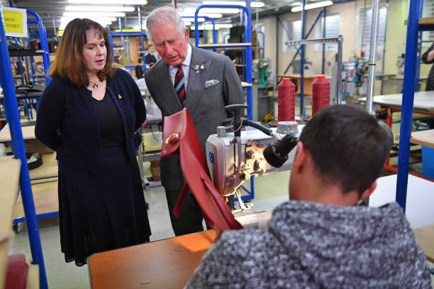 Prince Charles Prince of Wales with founder Julie Deane during a visit to The Cambridge Satchel Company where he toured the company's workshops and...