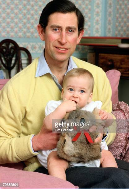 Prince Charles Prince of Wales with his baby son Prince William in the sitting room of their Kensington Palace home