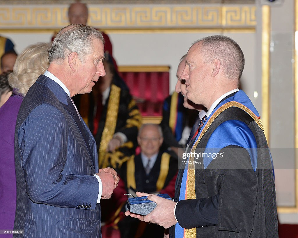 Prince Charles, Prince of Wales with Mr Michael Robbins of the Bridgewater College, during the presentation of The Queen's Anniversary Prizes for higher and further education, at a ceremony in Buckingham Palace on February 25, 2016 in London, England.