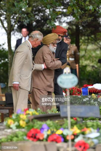 Prince Charles Prince of Wales WWII and veteran Darbara Singh Bhullar lay a wreath during a national service of remembrance marking the 75th...